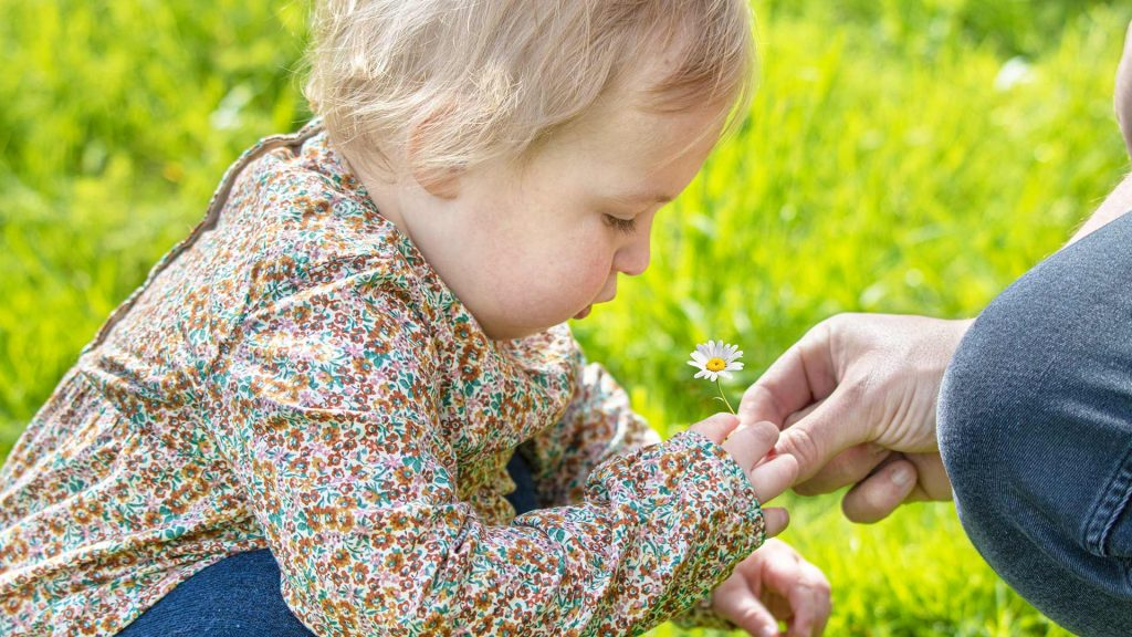 Child with daisy